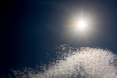 Sunshine in dark sky Stock Photography