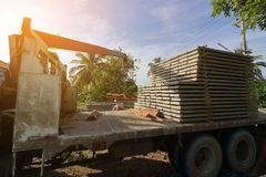 Sunshine effect, Stack of prestressed concrete slabs loaded on truck for construction Royalty Free Stock Images