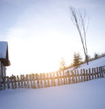 Sunshine and fence in snow Stock Images