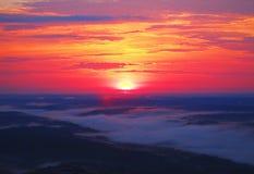 Sunshine fog. A natural landscape at sunrise with a fog filled valley stock photo