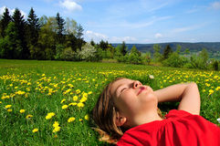 Sunshine girl on meadow Royalty Free Stock Image