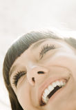 Sunshine happiness. Special light volume photo f/x, toned, focus point on eye Royalty Free Stock Image