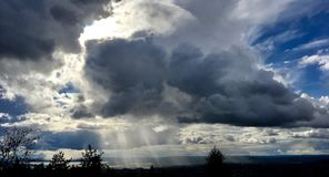 Sunshine through heavy clouds. View from Grefsenkollen in Oslo, Norway Royalty Free Stock Photo