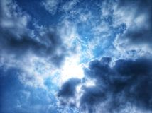 sunshine hidden by clouds stock photo
