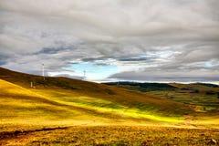 Sunshine lighting up the mountain grassland Stock Photo