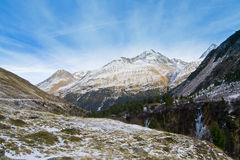 Sunshine and montains. Sunshine, blue sky and frozen creek between the montains Royalty Free Stock Photo