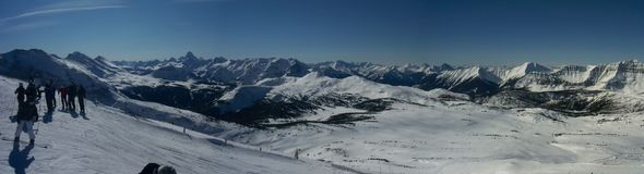 Sunshine Mountain. Skiers with surrounding view, Alberta Canada Stock Photography