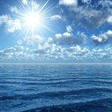 Sunshine upon the ocean. 3d render of sunny sky on a wavy ocean Royalty Free Stock Photography