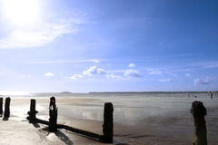 Sunshine over the beach breakers Stock Photography