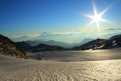 Sunshine over a big glacier. In the french alps during summer Royalty Free Stock Image