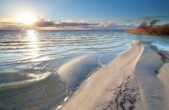 Sunshine over big Ijsselmeer lake coast. Friesland, Netherlands Stock Photos