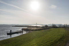 Sunshine over dutch ijsselmeer. Lake in the north of holland Stock Photo