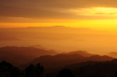Sunshine over the fog hill, northern Thailand Stock Photos