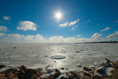 Sunshine over frozen Baltic sea. Royalty Free Stock Photography