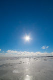 Sunshine over frozen Baltic sea. Royalty Free Stock Photos