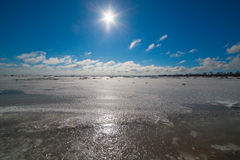Sunshine over frozen Baltic sea. Stock Images