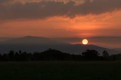 Sunshine over a mountain Stock Image