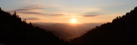Sunshine over Mountain Valley - panorama. The early light of dawn over the Smoky Mountains National Park, USA.  A stitched panorama Stock Images