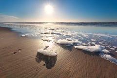 Sunshine over North sea waves on beach Stock Photos