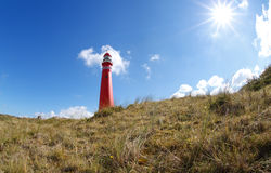 Sunshine over red lighthouse Royalty Free Stock Photography