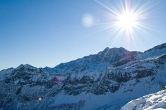 Sunshine over snowy mountains Royalty Free Stock Image