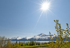 Sunshine over Turnagain Arm. Scenic view of sunshine over Turnagain Arm fjord with snow capped mountains in background, Alaska, U.S.A Stock Images