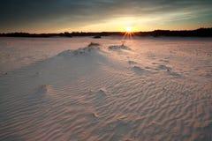 Sunshine over windy sand dunes at sunset Royalty Free Stock Image