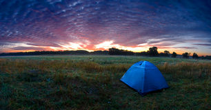Sunshine rising over a tent. In the wilderness Royalty Free Stock Photo
