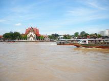 Sunshine on the river with boat red roof of temple. From thailand holidays travel Stock Photos