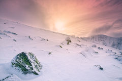 Sunshine in the rocky snowy mountains, Europe Royalty Free Stock Photography