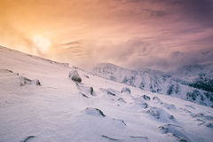 Sunshine in the rocky snowy mountains, Europe Stock Photo
