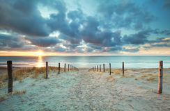 Sunshine on sand path to sea beach Stock Image