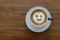 Sunshine shape coffee. The sunshine shape coffee on the wood table Stock Images