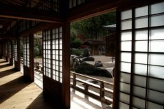 Sunshine in shinto monastery in Mount Koya, Japan. Shinto male monastery in Koyasan, Wakayama, Japan - traditional house with paper doors, wide open, wooden royalty free stock photography