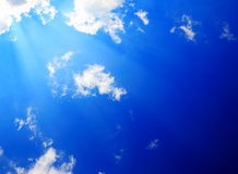 Sunshine in sky. Sunshine bursts through the clouds Royalty Free Stock Images