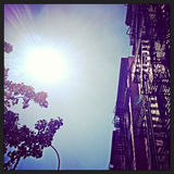Sunshine and Sky in New York City. Looking up at the sky and direct sunshine in New York City with Instagram effect filter Royalty Free Stock Photos