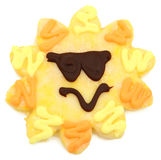 Sunshine Sugar Cookie. Large yellow sugar cookie shaped like a sunshine face with sunglasses over white background Stock Photo