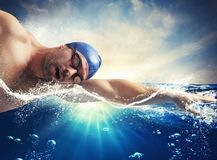 Sunshine swimmer. Swimmer swims in the sea in sunshine Royalty Free Stock Photos