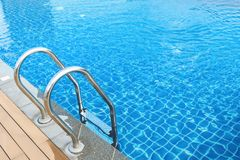 Sunshine on swimming pool. Sunshine and clear water of swimming pool royalty free stock images