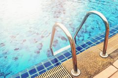 Sunshine on swimming pool. Sunshine and clear water of swimming pool Royalty Free Stock Image