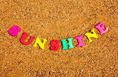 Sunshine. The word sunshine written in alphabet letters on a sand background Stock Photography