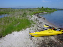 Sunshine yellow kayak on the beach Royalty Free Stock Images