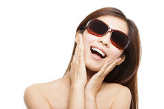 Sunshine young woman smiling and touching her face Stock Photo