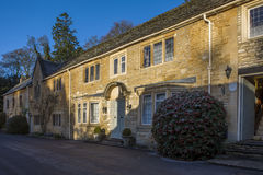 Sunshined and shadowed West street view in historic Castle Combe Stock Photography