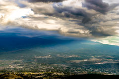 Sunshines and lights. Panorama photograph of the the back of the mount Vodno in SKopje ,Sunshones are shining the small village Royalty Free Stock Images
