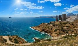 Sunshiny Benidorm coast Spain. Skyscrapers on rocky sunshiny coast. Benidorm city coastline summer view Costa Blanca, Alicante, Spain Royalty Free Stock Photos