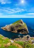 Sunshiny Cape Vidio Asturias, Spain. Summer blossoming Cape Vidio sunshiny coast view with flowers Asturias, Cudillero, Spain Stock Images