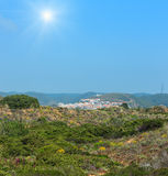 Sunshiny Carrapateira village, Portugal. Sunshiny Carrapateira village on western coast of Algarve, Portugal. Summer misty view Royalty Free Stock Images