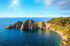 Sunshiny Del Silencio beach (Asturias, Spain). Summer sunshiny top view on Del Silencio (Gaviero) beach (Biscay Bay, Asturias, Spain). Atlantic Ocean coastline Stock Images