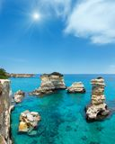 Sunshiny Faraglioni at Torre Sant Andrea, Italy. Picturesque sunshiny seascape with cliffs and stacks faraglioni, at Torre Sant Andrea, Salento sea coast, Puglia Royalty Free Stock Photos